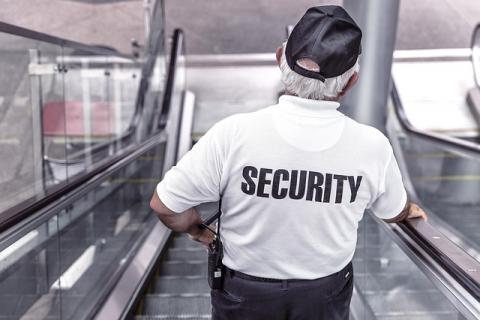 Security Guy using the escalator
